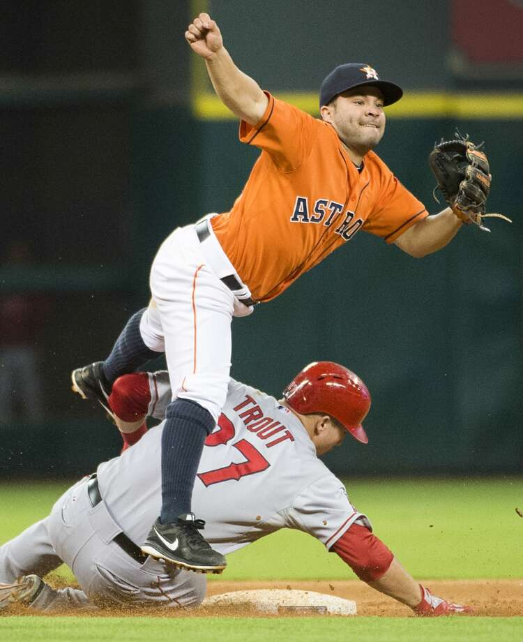Astros second baseman Jose Altuve makes the relay to turn a double play to get the Astros out of a bases-loaded jam during the eighth inning. Photo: Smiley N. Pool, Houston Chronicle