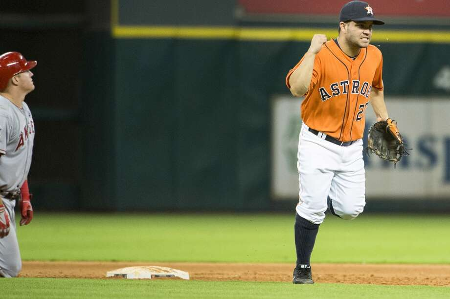 Astros second baseman Jose Altuve celebrates after turning a double play to end the eighth inning. Photo: Smiley N. Pool, Houston Chronicle