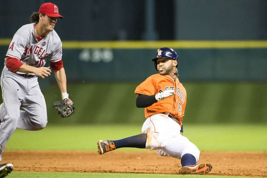 Angels second baseman Grant Green gives chase to Astros shortstop Jonathan Villar as he is caught in a rundown during the eighth inning. Photo: Smiley N. Pool, Houston Chronicle