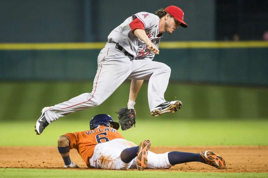 Angels second baseman Grant Green leaps over Astros shortstop Jonathan Villar after tagging him out in a rundown. Photo: Smiley N. Pool, Houston Chronicle