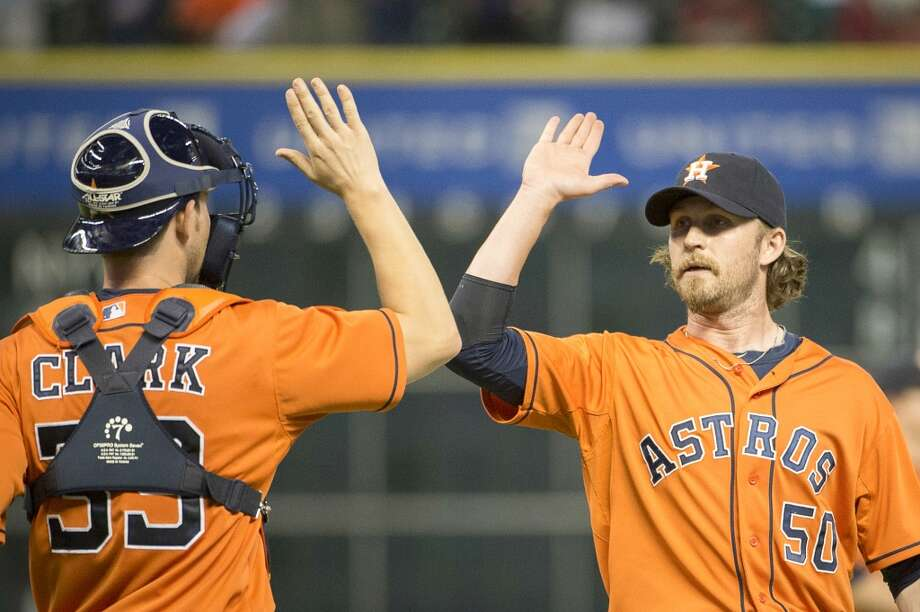 Astros relief pitcher Josh Fields celebrates with catcher Cody Clark after picking up the save in a victory over the Angels. Photo: Smiley N. Pool, Houston Chronicle