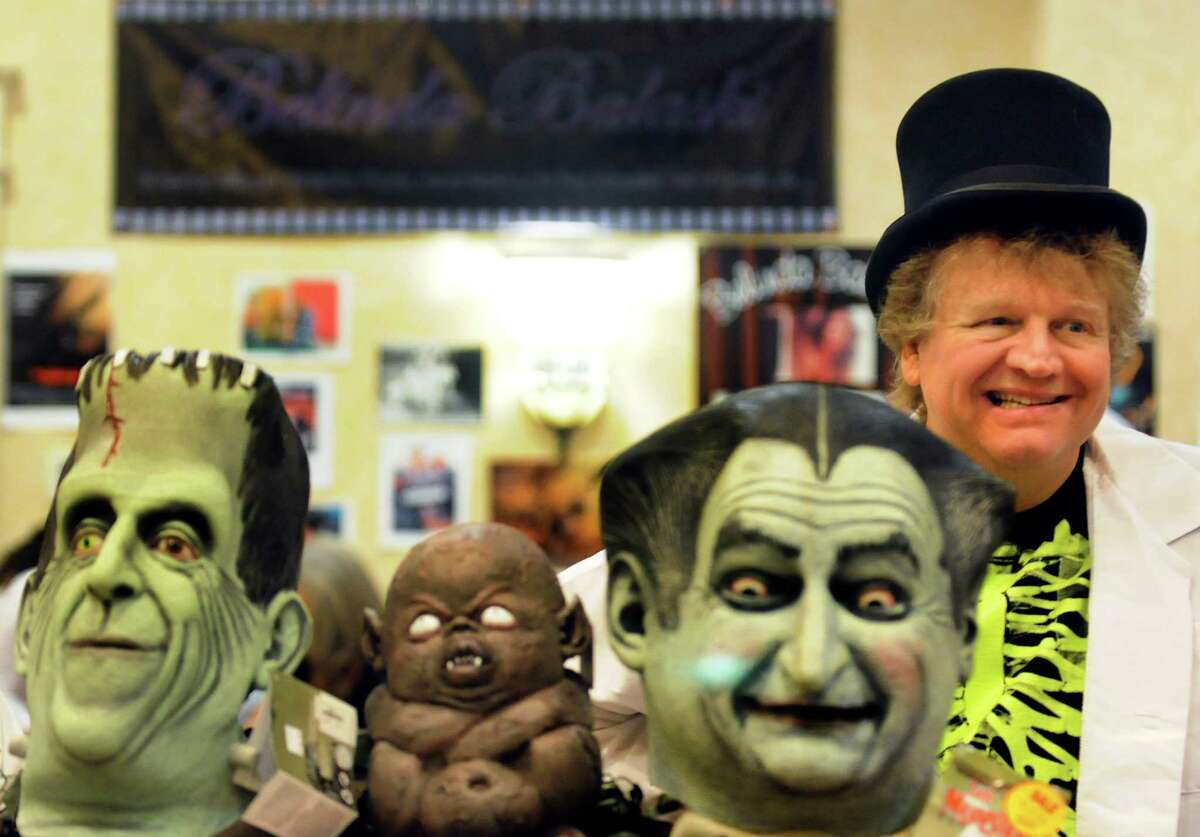 Salesman Scott R. Payne works The Costumer booth during FantaCon 2013 on Saturday, Sept. 14, 2013, at the Marriott Hotel in Colonie, N.Y. The comic book, horror and fantasy convention continues Sunday from 10 a.m. to 5 p.m. (Cindy Schultz / Times Union)