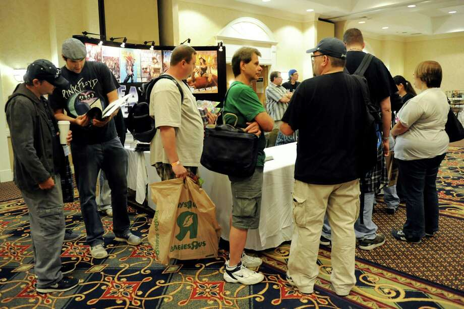 Fans of Teenage Mutant Ninja Turtles line up to meet creator Kevin Eastman during FantaCon 2013 on Saturday, Sept. 14, 2013, at the Marriott Hotel in Colonie, N.Y. The comic book, horror and fantasy convention continues Sunday from 10 a.m. to 5 p.m. (Cindy Schultz / Times Union) Photo: Cindy Schultz / 00023870A