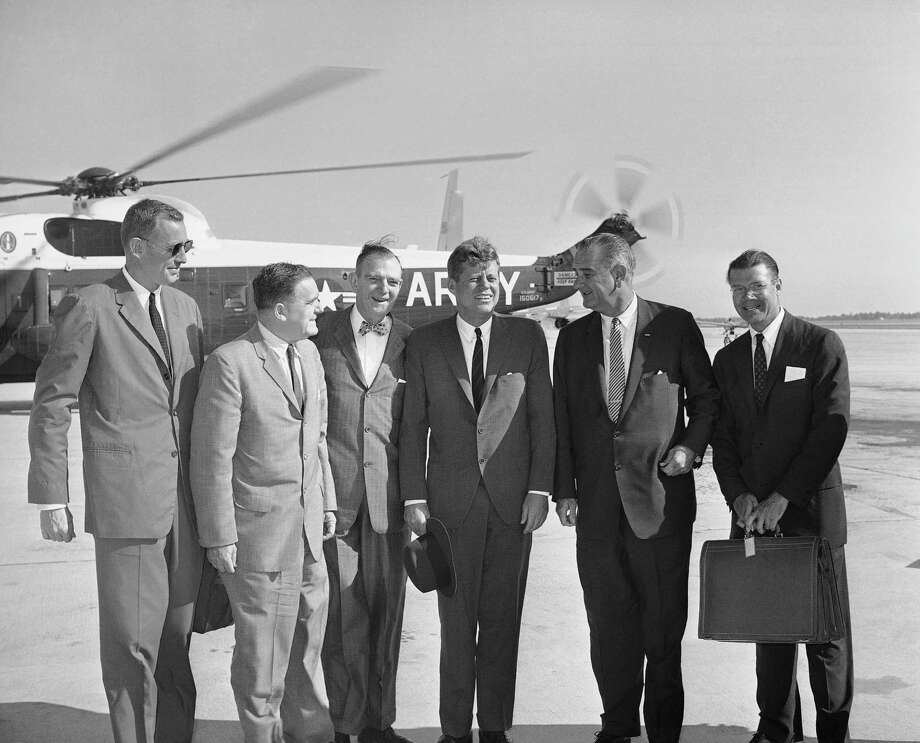 President John Kennedy poses with members of his party before air takeoff on Sept. 11, 1962 at Andrews Air Force Base for an inspection tour of space centers.    From left Budget Director David Bell, NASA  administer James Webb, Rep. Albert Thomas, D-Texas, Kennedy; Vice President Lyndon Johnson, and Defense Secretary Robert McNamara. Photo: Bill Allen, ASSOCIATED PRESS / AP1962