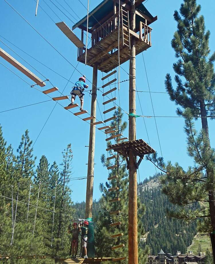 Kids frolic among the trees on the Squaw Valley high ropes course, an activity that works in the fall season between summer recreation and the start of winter sports. Photo: Bill Fink
