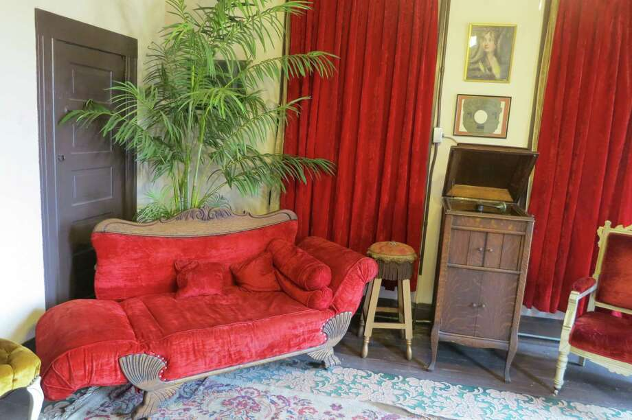 The parlor at the top of the stairs is decorated as it would have been in the early 1900s at Miss Hattie's Bordello Museum on East Concho Street downtown San Angelo, Texas. Miss Hattie's Parlor was one of several dozen brothels in downtown San Angelo a century ago. Photo: Joe Holley, Houston Chronicle / Houston Chronicle