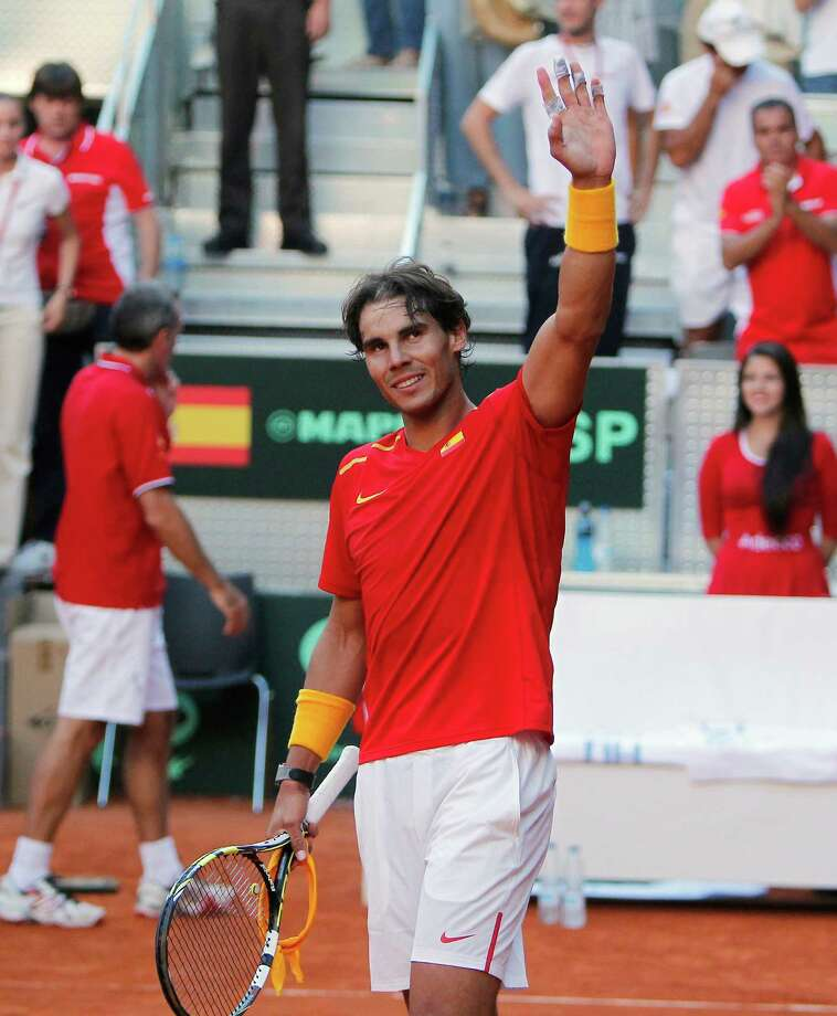 Spain's Rafael Nadal celebrates his victory during a match against Ukraine's Sergiy Stakhovky on the first day of the World Group play-off Davis Cup tennis in Madrid, Spain, Friday, Sept. 13, 2013. (AP Photo/Andres Kudacki) ORG XMIT: AK127 Photo: Andres Kudacki / AP