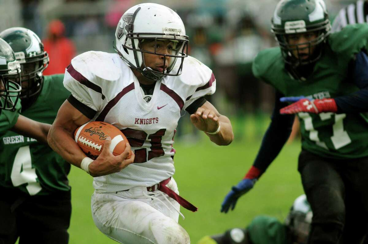 Lansingburgh's Anthony Walker, center, carries the ball during their football game against Green Tech on Saturday, Sept. 14, 2013, at Bleecker Stadium in Albany, N.Y. (Cindy Schultz / Times Union)