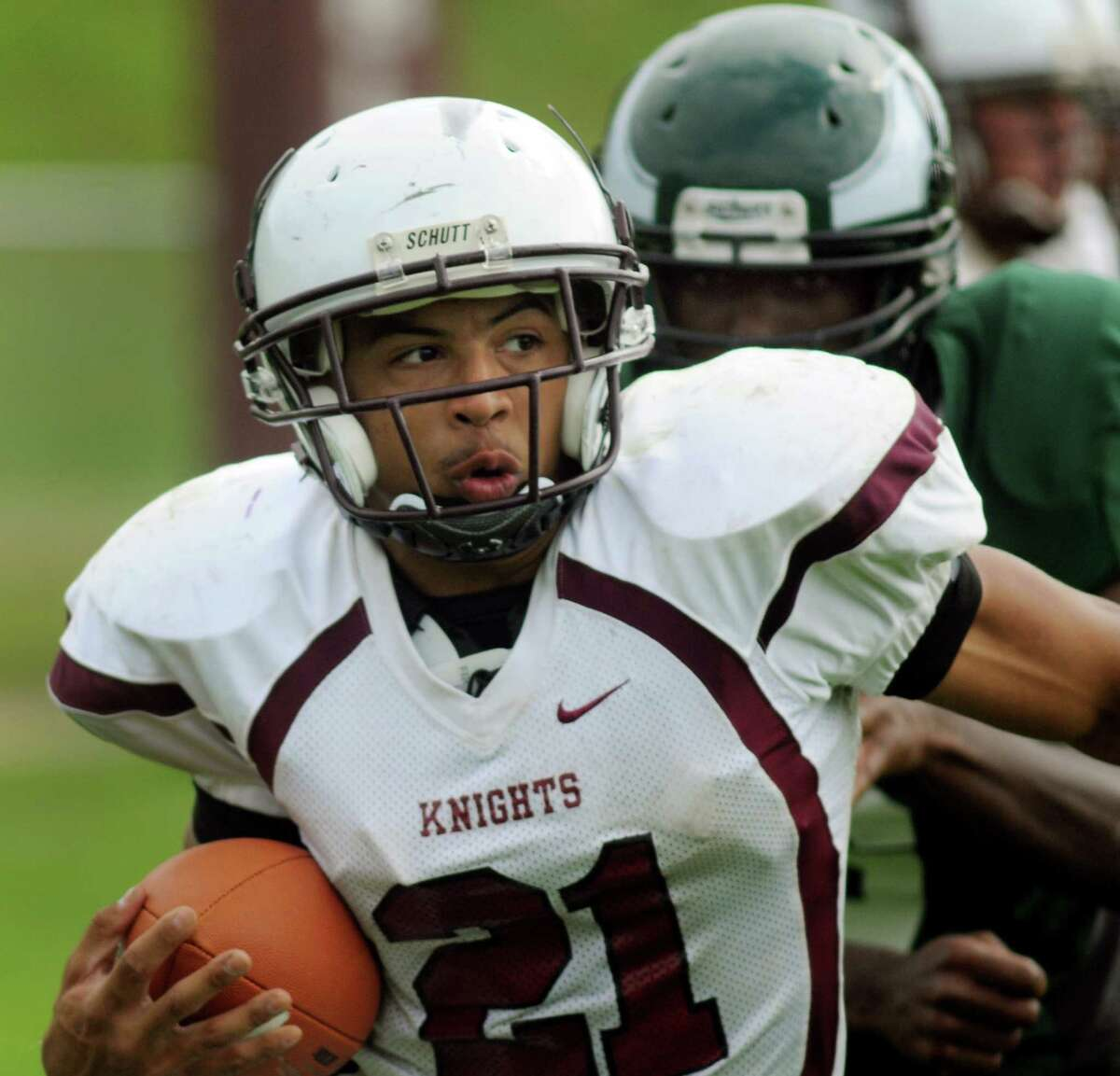 Lansingburgh's Anthony Walker carries the ball during their football game against Green Tech on Saturday, Sept. 14, 2013, at Bleecker Stadium in Albany, N.Y. (Cindy Schultz / Times Union)