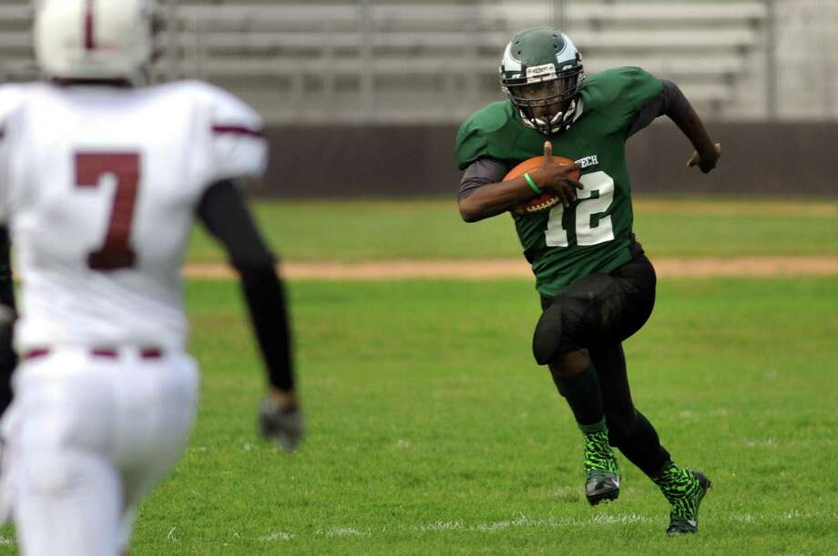 Green Tech's Raeshawn Joseph returns a kickoff during their football game against Lansingburgh on Saturday, Sept. 14, 2013, at Bleecker Stadium in Albany, N.Y. (Cindy Schultz / Times Union) Photo: Cindy Schultz / 00023836A