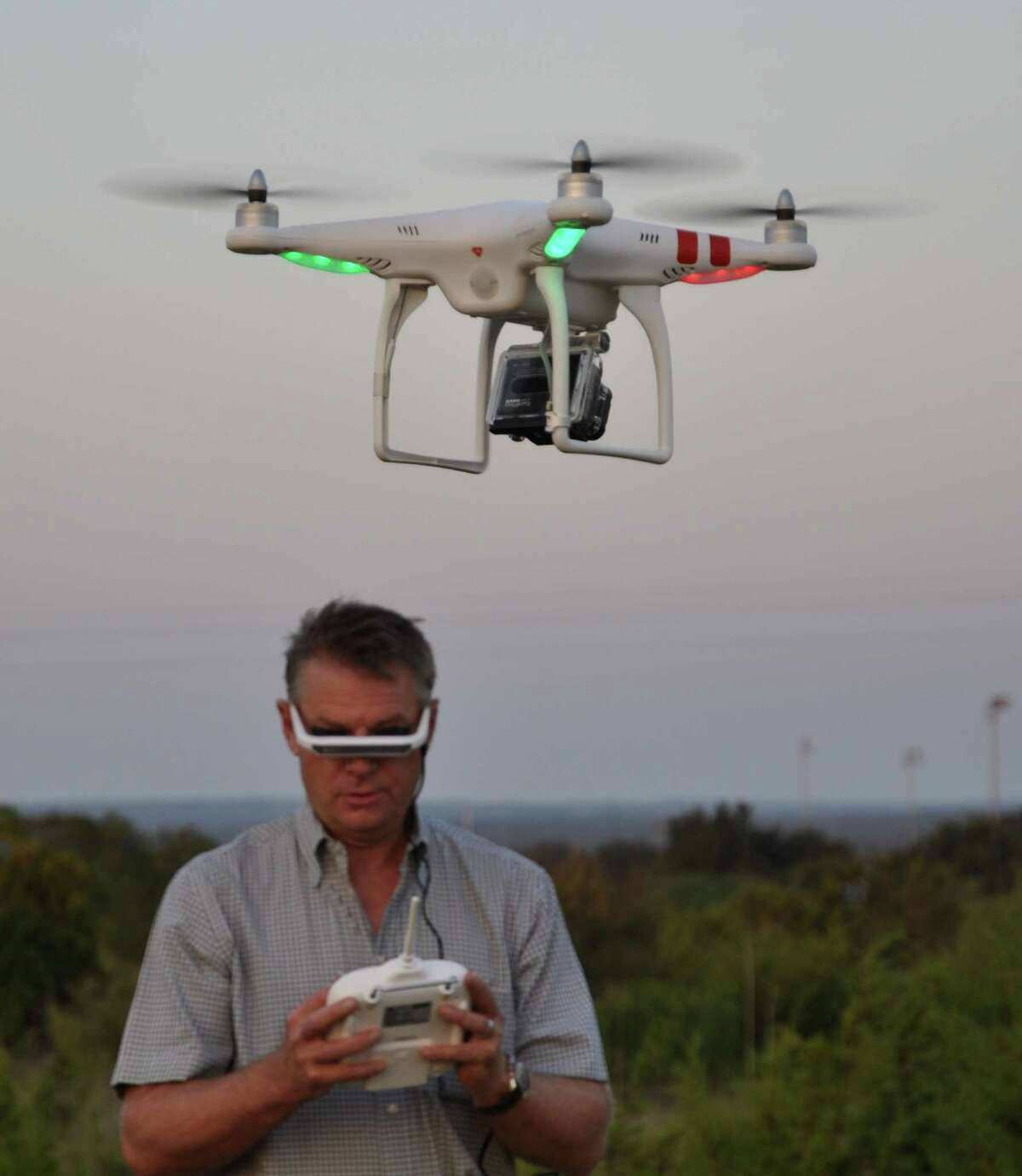 Steve Klindworth, CEO of UAVDirect, operates a drone copter he sells for $979.95 along with camera and goggles. The system allows the operator to fly the aircraft while seeing the view from the aircraft in real time.