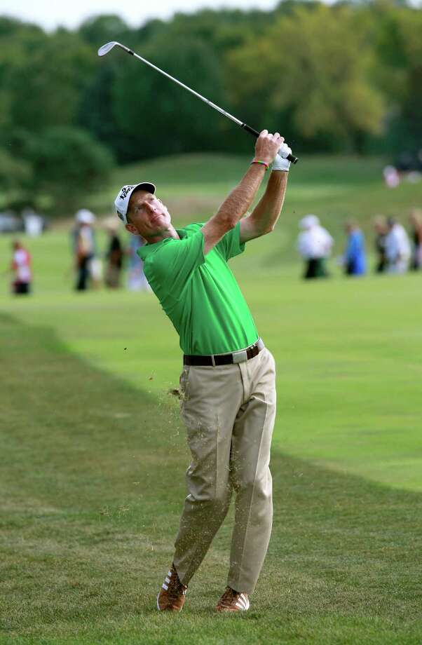 LAKE FOREST, IL - SEPTEMBER 14: Jim Furyk hits a shot on the 18th hole during the Third Round of the BMW Championship at Conway Farms Golf Club on September 14, 2013 in Lake Forest, Illinois.  (Photo by Sam Greenwood/Getty Images) ORG XMIT: 159810245 Photo: Sam Greenwood / 2013 Getty Images