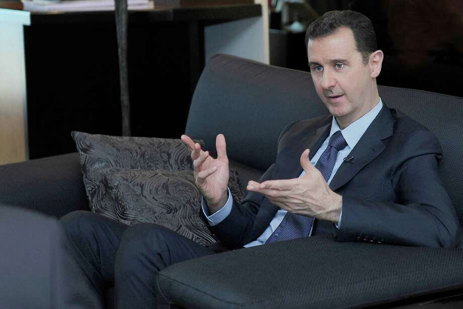 "Syria President Bashar Assad complied to destroy the chemical weapons arsenal. The deal requires ""immediate and unfettered"" access to weapons sites by inspectors. Photo: SANA / Associated Press"
