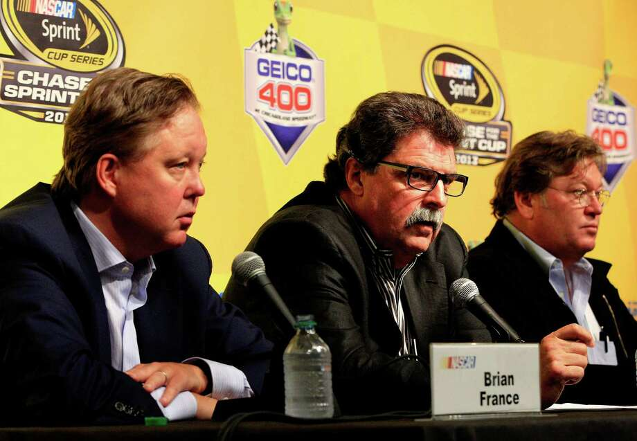 JOLIET, IL - SEPTEMBER 14:  (L-R) Brian France, chairman & CEO of NASCAR, Mike Helton, president of NASCAR, and Robin Pemberton, NASCAR Vice President, hold a press conference following a meeting with drivers for the NASCAR Sprint Cup Series at Chicagoland Speedway on September 14, 2013 in Joliet, Illinois.  (Photo by Sean Gardner/Getty Images) ORG XMIT: 180389498 Photo: Sean Gardner / 2013 Getty Images