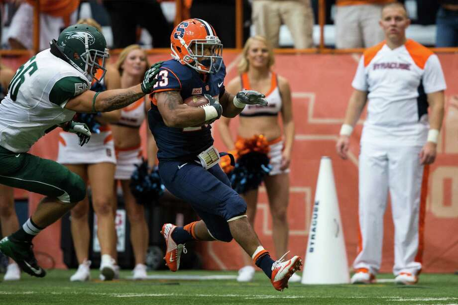 SYRACUSE, NY - SEPTEMBER 14:  Prince-Tyson Gulley #23 of Syracuse Orange breaks past Greg Hillard #56 of Wagner Seahawks for Syracuse's second touchdown on September 14, 2013 at the Carrier Dome in Syracuse, New York.  Syracuse Orange won 54-0.  (Photo by Brett Carlsen/Getty Images) Photo: Brett Carlsen / 2013 Brett Carlsen