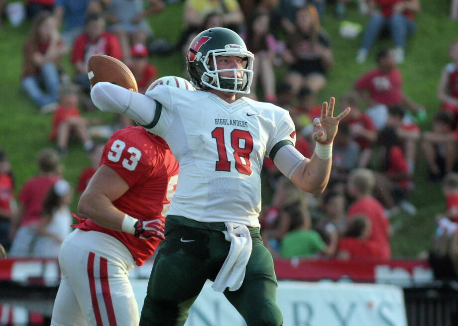 The Woodlands junior quarterback Chris Andritsos looks for a receiver against Katy during first quarter action of their non-district matchup at Rhodes Stadium on Saturday. Photo: Jerry Baker, For The Chronicle