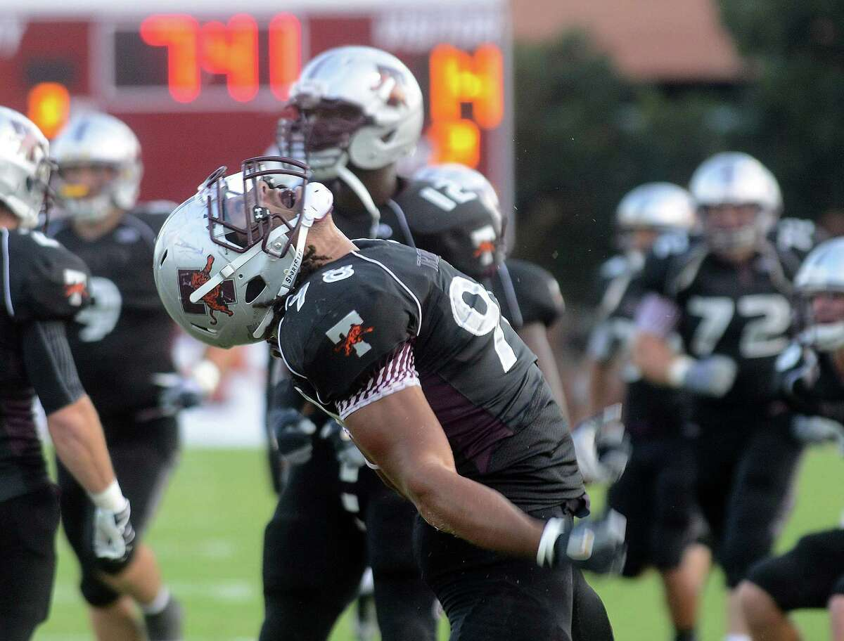 Trinity defensive lineman Bradley Drenon celebrates after the defense made a successful goal line stance against Texas Lutheran during college football action at Trinity University on Saturday, Sept. 14, 2013.