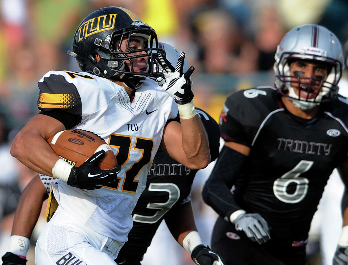 A.J. Saucedo of Texas Lutheran runs for a score against Trinity during college football action at Trinity University on Saturday, Sept. 14, 2013.