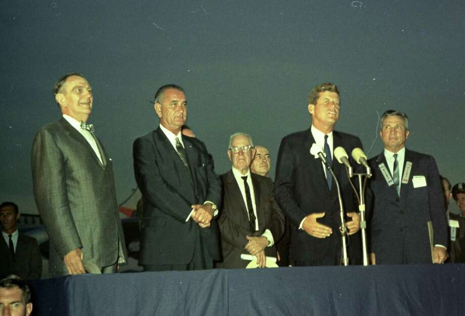 09/11/1962 - President John F. Kennedy arrives at International Airport in Houston to huddle with NASA's leadership and address a national audience from Rice to bolster his initiative to land American astronauts on the moon. President Kennedy speaks at the airport. L-R  U.S. Rep. Albert Thomas, Vice President Lyndon Johnson, unidentified man, President Kennedy, Houston Mayor Lewis Cutrer. Photo: HC Staff / Houston Chronicle