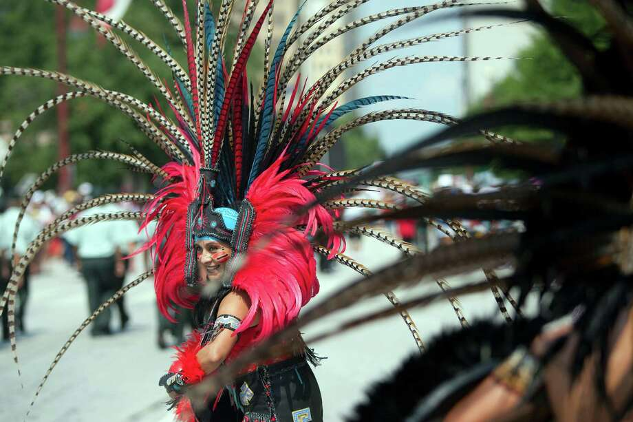 Alajandra Tapia, an Aztec dancer, performs as the 45th annual Fiestas Patrias International Parade made its way down Texas Street near Minute Maid Park Saturday, Sept. 14, 2013, in Houston. Photo: Johnny Hanson, Houston Chronicle / Houston Chronicle