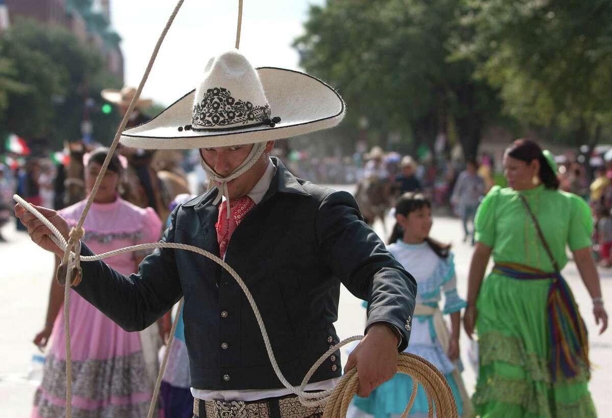 Roper Javier Cantu performs in the 45th annual Fiestas Patrias International Parade.