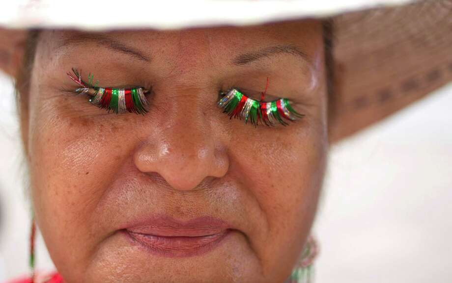 Rosara Mondragon wore Mexican Flag inspired eye lashes to the 45th annual Fiestas Patrias International Parade on Texas Street near Minute Maid Park. Photo: Johnny Hanson, Houston Chronicle / Houston Chronicle