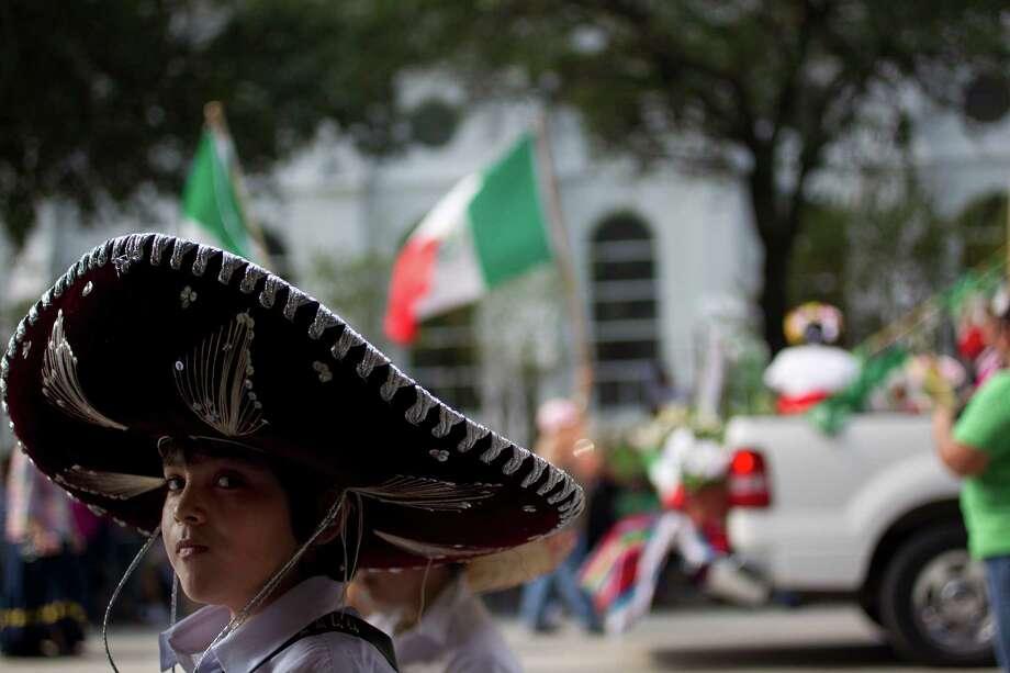 Brian Franco, 11, looks on as the 45th annual Fiestas Patrias International Parade made its way down Texas Street near Minute Maid Park. Photo: Johnny Hanson, Houston Chronicle / Houston Chronicle