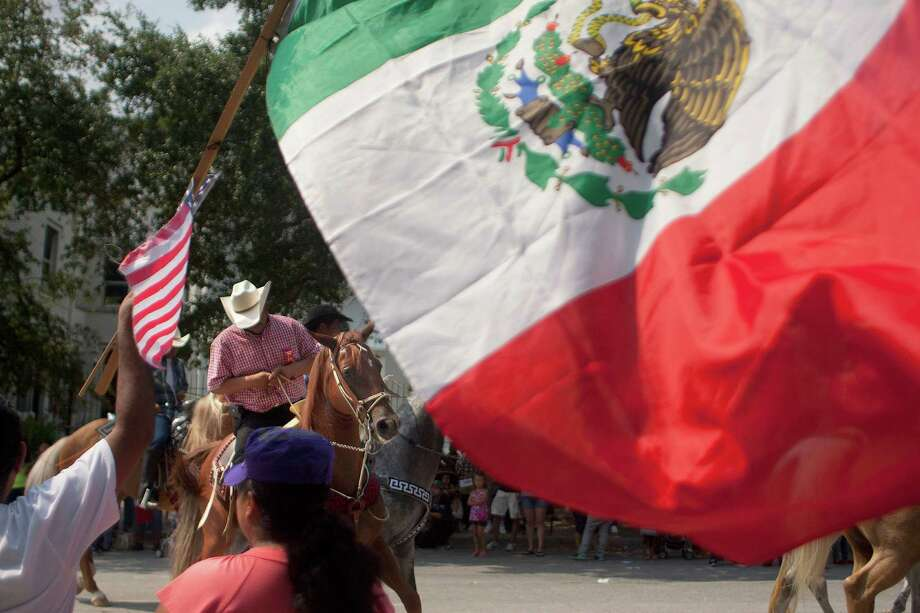 Flags waved as the 45th annual Fiestas Patrias International Parade made its way down Texas Street near Minute Maid Park. Photo: Johnny Hanson, Houston Chronicle / Houston Chronicle