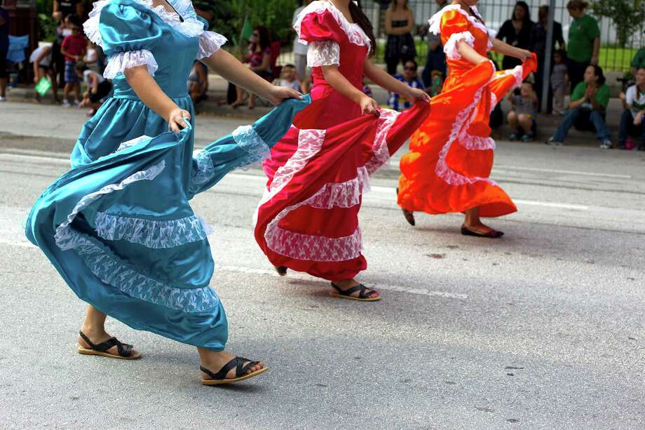 Guatemalan dancers perform as the 45th annual Fiestas Patrias International Parade made its way down Texas Street near Minute Maid Park. Photo: Johnny Hanson, Houston Chronicle / Houston Chronicle