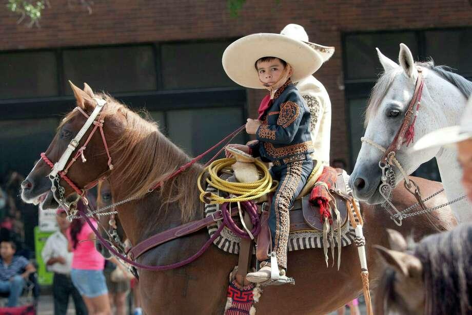 Gerardo Gutierrez, 7, rides his horse in the 45th annual Fiestas Patrias International Parade. Photo: Johnny Hanson, Houston Chronicle / Houston Chronicle