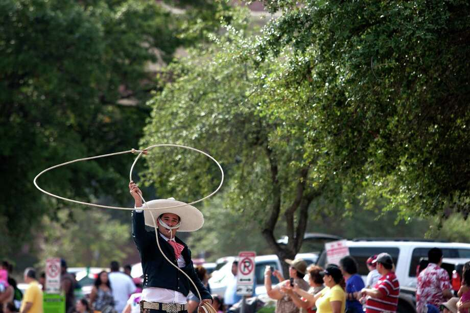 Roper Javier Cantu performs in the 45th annual Fiestas Patrias International Parade. Photo: Johnny Hanson, Houston Chronicle / Houston Chronicle