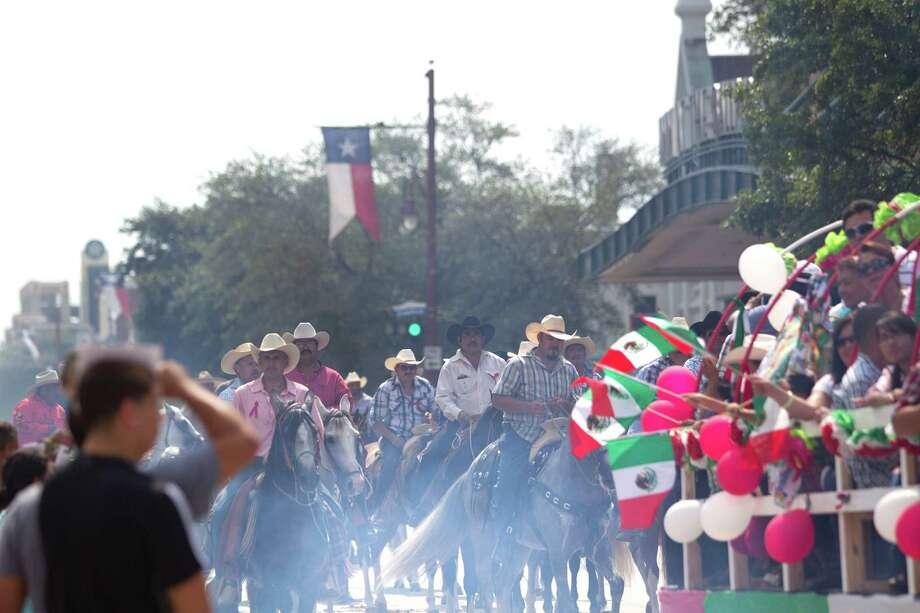 Flags waved as the 45th annual Fiestas Patrias International Parade made its way down Texas Street near Minute Maid Park. Photo: Johnny Hanson, Houston Chronicle / Houston Chronicle