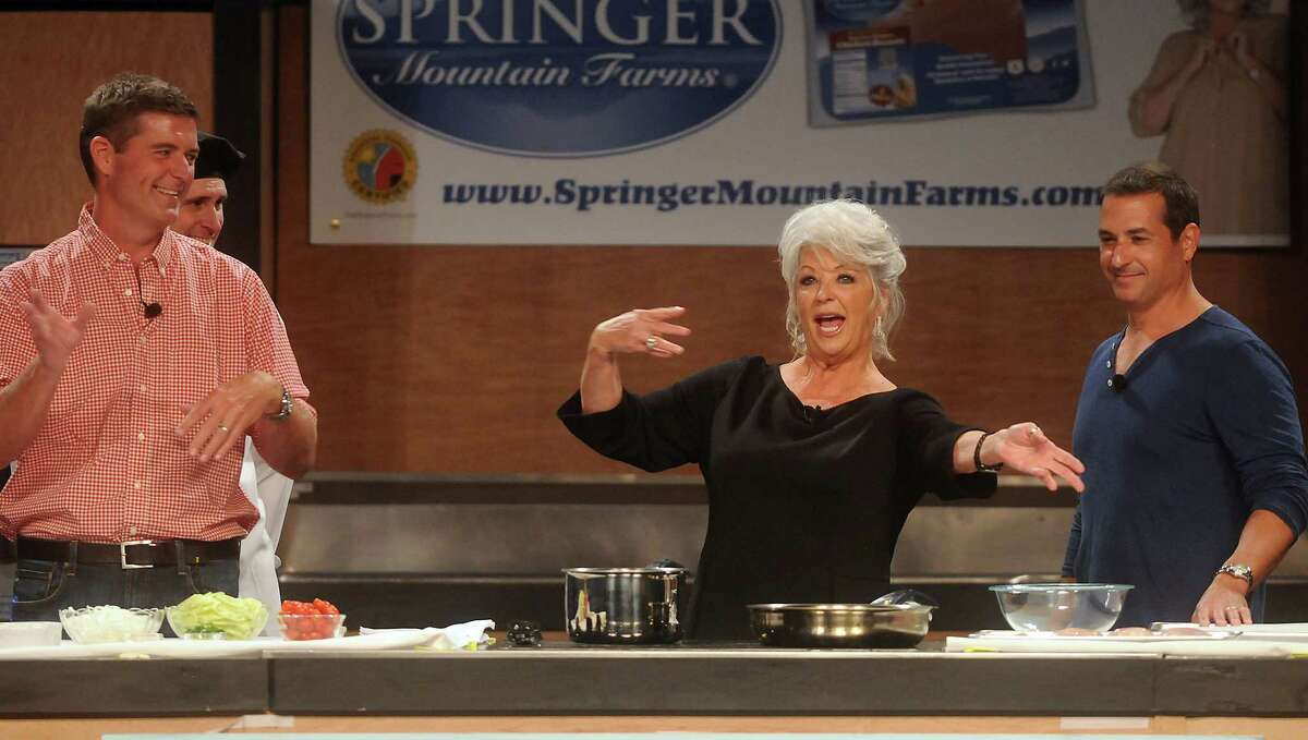 Chef Paula Deen thanks the crowd for their support at the Metropolitan Cooking & Entertaining Show at the Reliant Center Saturday Sept. 14 2013.Also pictured are Dean's sons Jamie and Bobby.