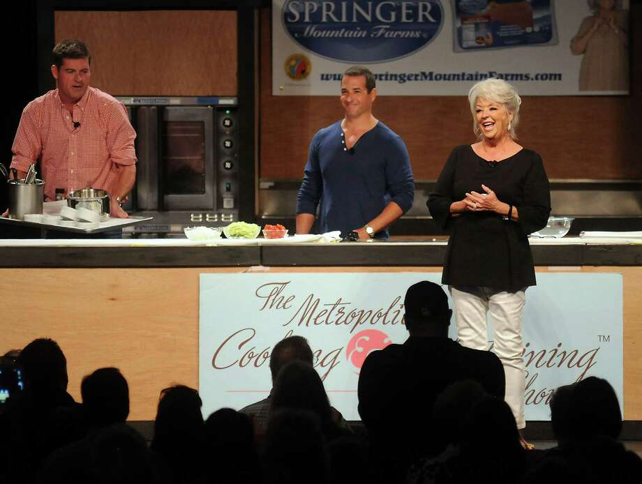 Chef Paula Deen thanks the crowd for their support at the Metropolitan Cooking & Entertaining Show at the Reliant Center Saturday Sept. 14 2013. Also pictured are Dean's sons Jamie and Bobby. Photo: Dave Rossman, For The Houston Chronicle / © 2013 Dave Rossman