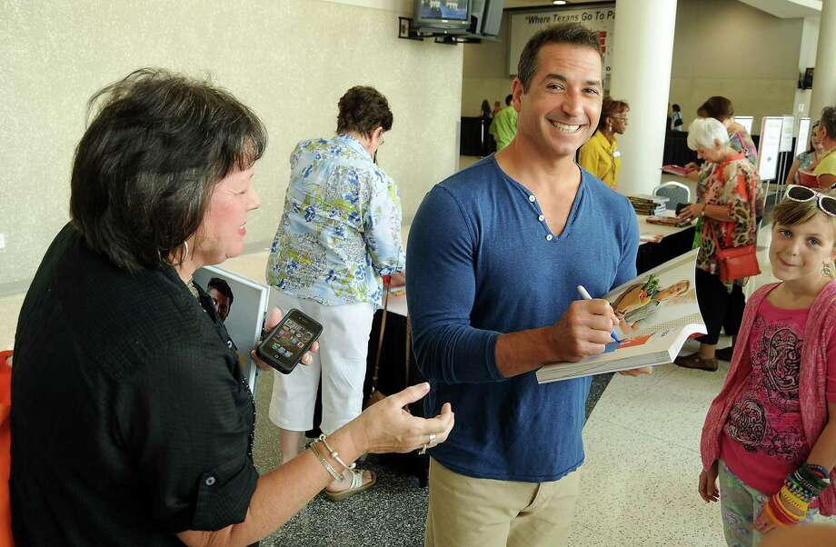 Bobby Deen signs cook books at the Metropolitan Cooking & Entertaining Show at the Reliant Center Saturday Sept. 14 2013. Photo: Dave Rossman, For The Houston Chronicle / © 2013 Dave Rossman