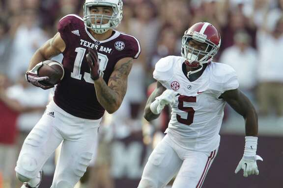 Mike Evans (13) caught seven of Manziel's passes for 279 yards and a 95-yard TD.