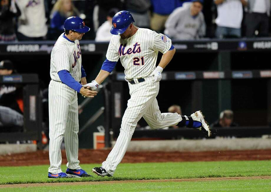 NEW YORK, NY - SEPTEMBER 14:  Lucas Duda #21 of the New York Mets celebrates a home run with third base coach Tim Teufel #18 during the third inning of game two of a doubleheader against the Miami Marlins on September 14, 2013 at Citi Field in the Flushing neighborhood of the Queens borough of New York City.  (Photo by Maddie Meyer/Getty Images) ORG XMIT: 163493980 Photo: Maddie Meyer / 2013 Getty Images