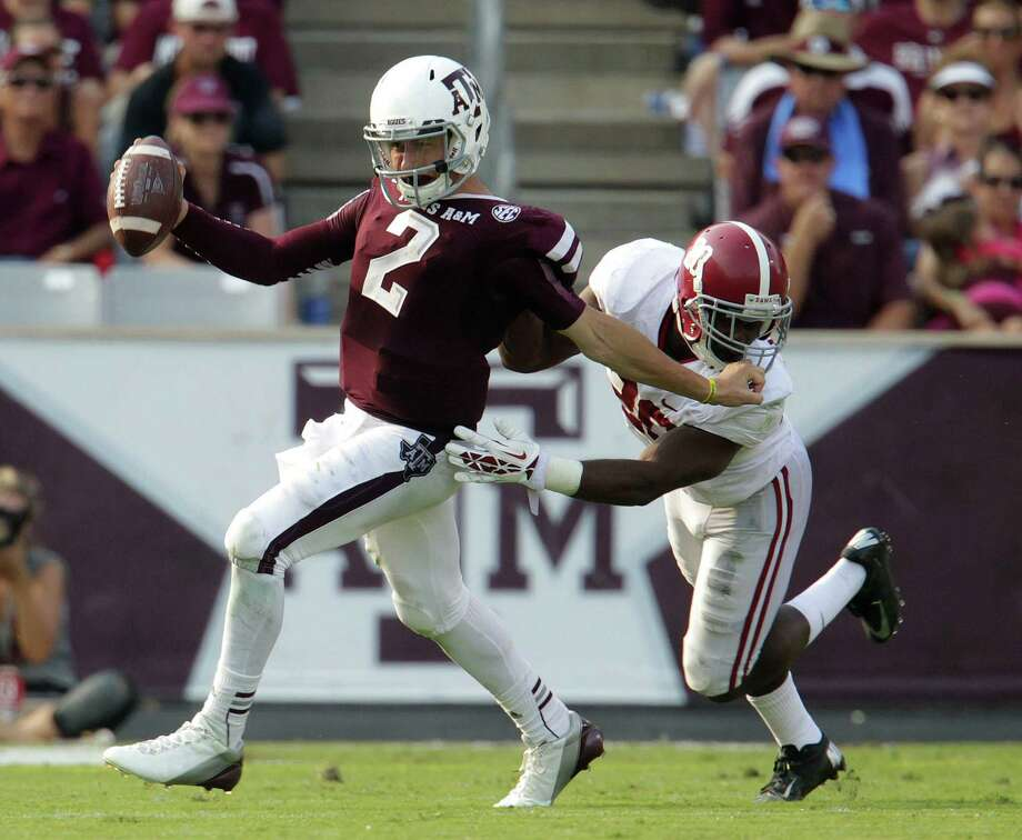 Just like his team, Texas A&M quarterback Johnny Manziel, left, gets caught from behind by Jarrick Williams and Alabama. Photo: Karen Warren, Staff / © 2013 Houston Chronicle