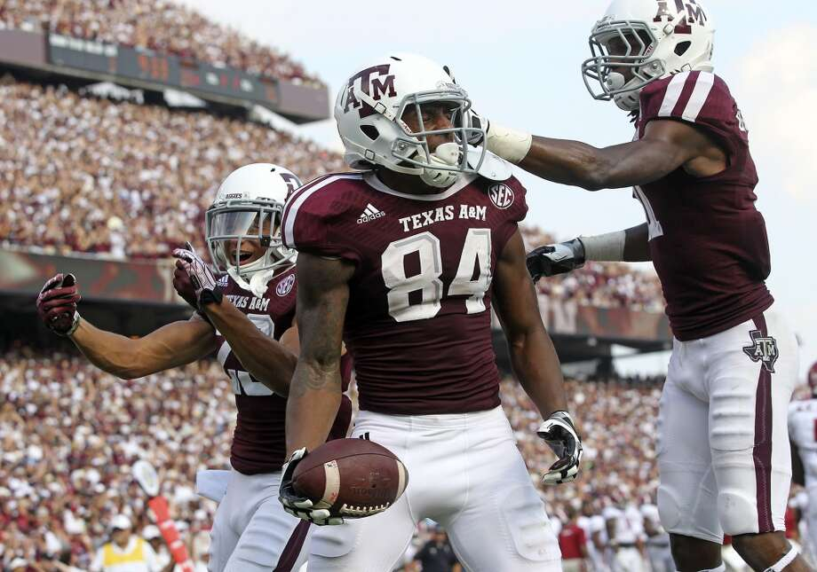 Malcome Kennedy celebrates a third quarter touchdown catch as  Texas A&M hosts Alabama at Kyle Field in College Station on September 14,  2013. Photo: TOM REEL