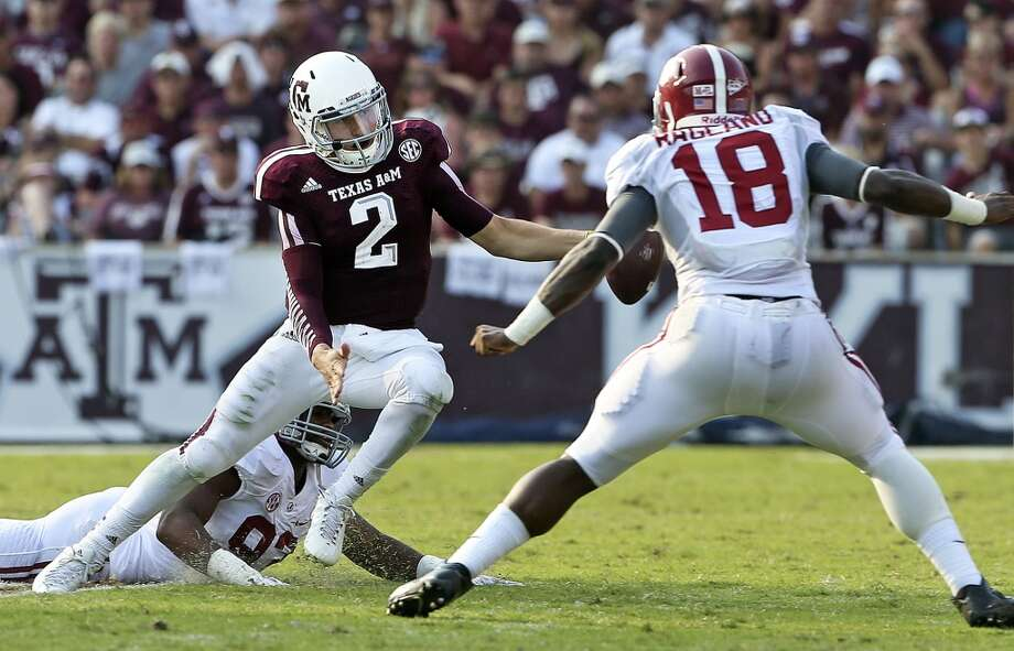 Aggie quarterback Johnny Manziel scrambles the field in the fourth quarter as  Texas A&M hosts Alabama at Kyle Field in College Station on September 14,  2013. Photo: TOM REEL