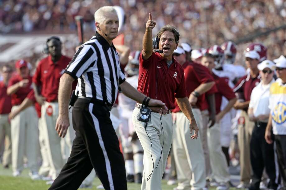 Coach Nick Saban tries to get the ref to look at the replay screen after he protests a call against Alabama as Texas A&M hosts Alabama at Kyle Field in College Station on September 14,  2013. Photo: TOM REEL