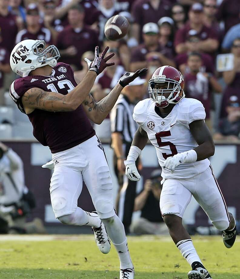 Mike Evans stretches to grab a pass and takes it 95 yards for a touchdown against Cyrus Jones as  Texas A&M hosts Alabama at Kyle Field in College Station on September 14,  2013. Photo: TOM REEL