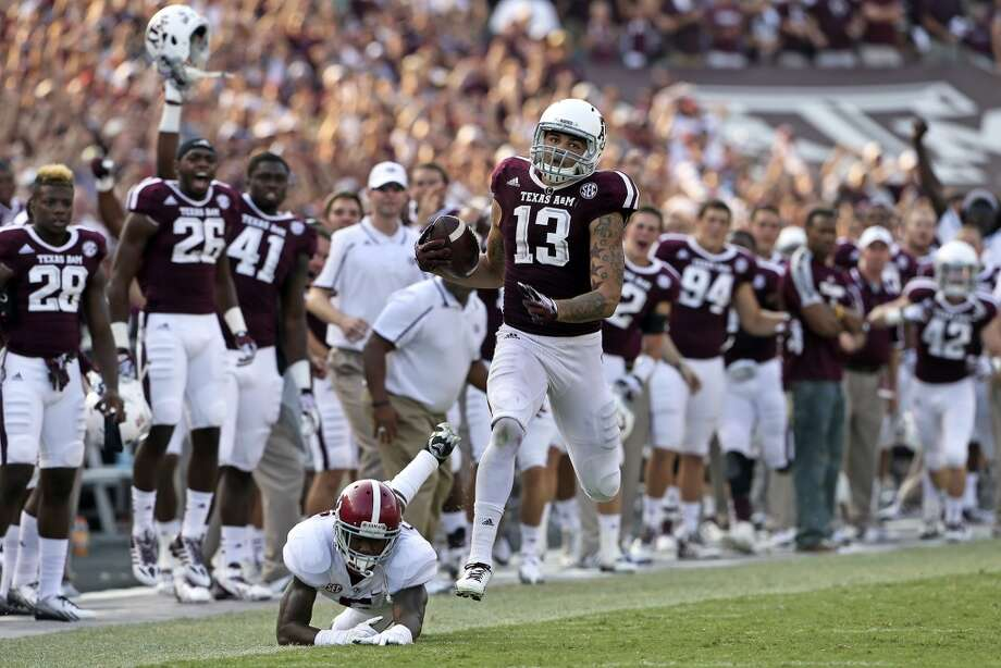 Mike Evans sprints after grabbing  a pass and takes it 95 yards for a touchdown against Cyrus Jones as  Texas A&M hosts Alabama at Kyle Field in College Station on September 14,  2013.  . Photo: TOM REEL
