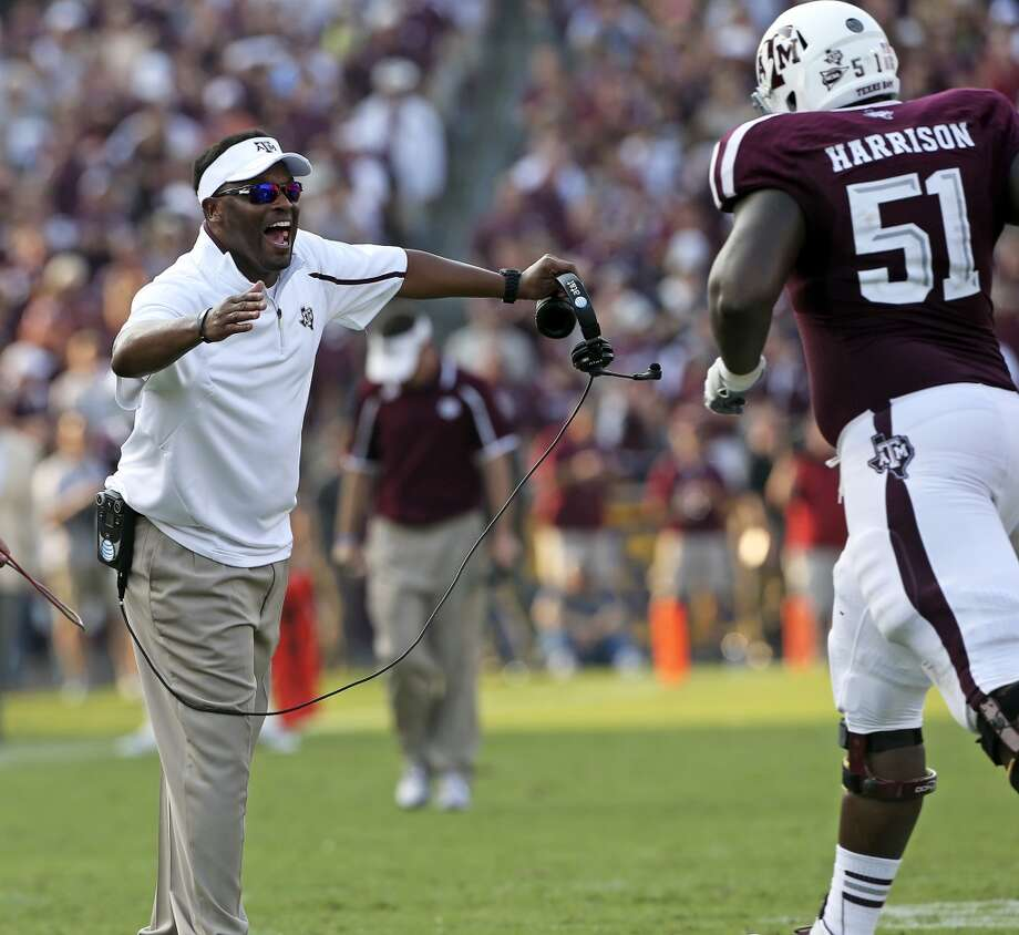 Aggie coach Kevin Sumlin congratulates lineman after a touchdown as Texas A&M hosts Alabama at Kyle Field in College Station on September 14,  2013. Photo: TOM REEL