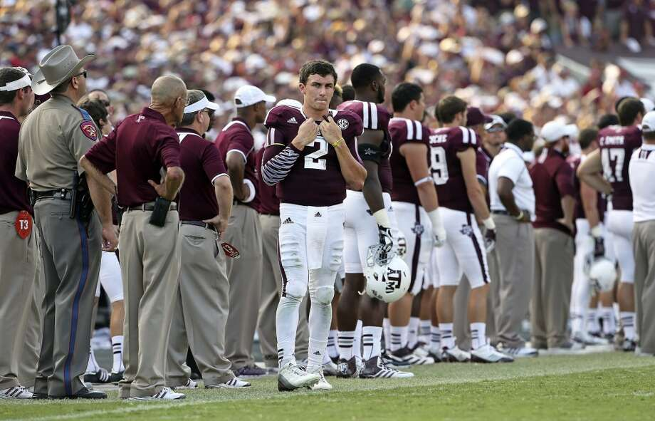 Aggie quarterback Johnny Manziel paces the sidelines in the fourth quarter as the Aggies draw near Texas A&M hosts Alabama at Kyle Field in College Station on September 14,  2013. Photo: TOM REEL