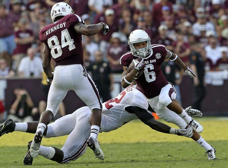 Brandon Williams returns the ball as  Texas A&M hosts Alabama at Kyle Field in College Station on September 14,  2013. Photo: TOM REEL