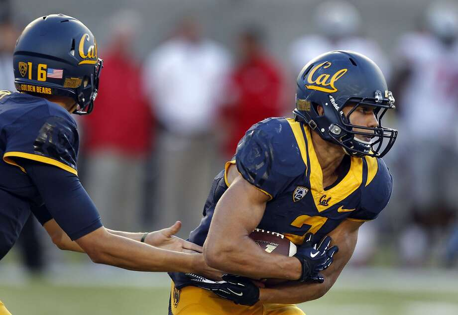 Cal quarterback Jared Goff, (16) hands off to running back Daniel Lasco, (2) on a third quarter run as the California Golden Bears went on to lose to the Ohio State Buckeyes 52-34 at Memorial Stadium on Saturday Sept. 14, 2013 in Berkeley, Calif. Photo: Michael Macor, The Chronicle
