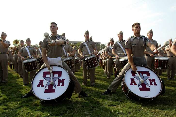 The Texas A&M drum corps and band plays at the ESPN Game Day events on the A&M campus before the start of the Alabama game, Saturday, Sept. 14, 2013, in College Station.
