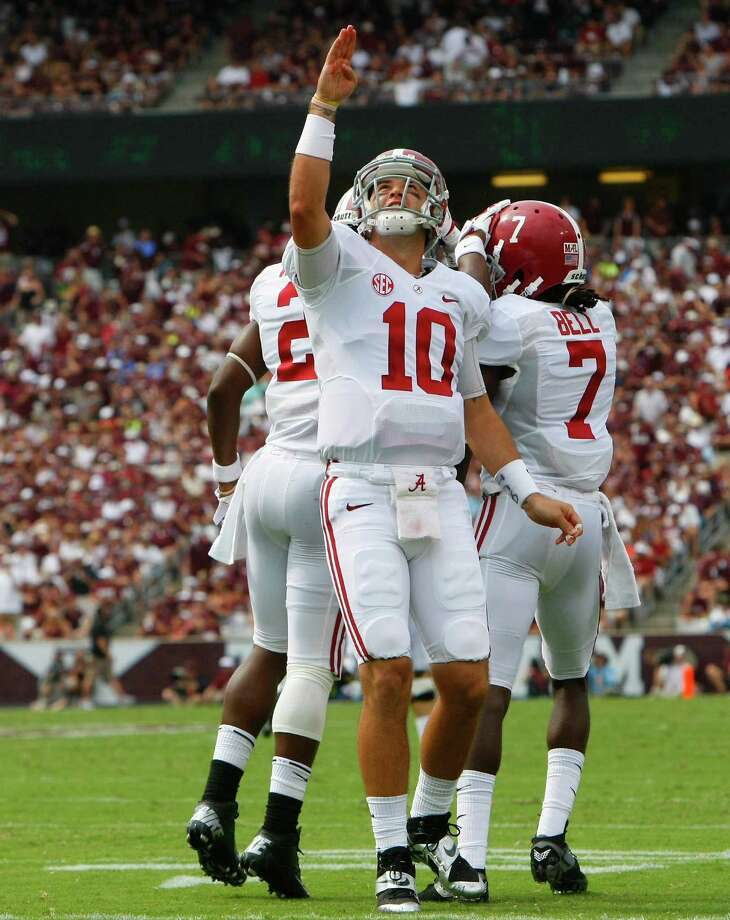 Alabama Crimson Tide quarterback AJ McCarron celebrates after teammate Kenny Bell scored a touchdown during the second quarter of a college football game against the Texas A&M Aggies at Kyle Field Saturday, Sept. 14, 2013, in College Station. Photo: Cody Duty, Houston Chronicle / © 2013 Houston Chronicle