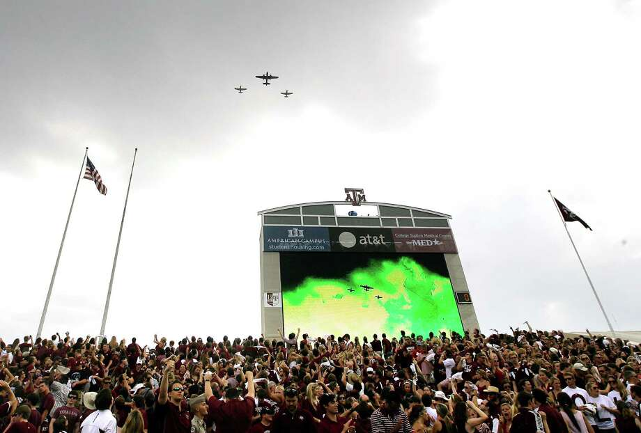 Fans watch during a flyover after the National Anthem before a college football game between the Alabama Crimson Tide and Texas A&M Aggies at Kyle Field Saturday, Sept. 14, 2013, in College Station. Photo: Cody Duty, Houston Chronicle / © 2013 Houston Chronicle